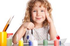 Girl, draws paint stock photo