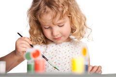 Girl, draws paint Royalty Free Stock Photo