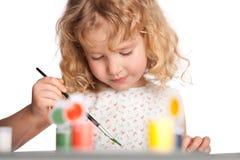 Girl, draws paint Royalty Free Stock Photo