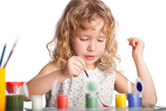 Girl, draws paint Royalty Free Stock Photos