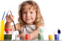 Girl, draws paint royalty free stock image