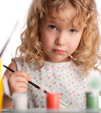 Girl, draws paint Royalty Free Stock Photography