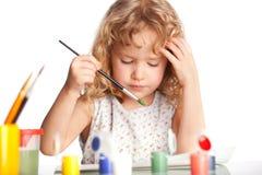 Girl, draws paint Stock Photos