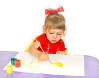 The girl draws paints. The girl it is carried away draws paints a horsy. A white background stock photo