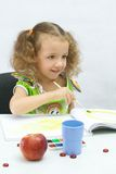 The girl draws by paints Royalty Free Stock Photography
