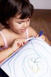 Girl draws paints Royalty Free Stock Photos