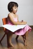 Girl draws paints Stock Photos