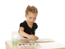 Girl draws paints Stock Photography