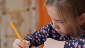Girl draws on paper. Little girl drawing - closeup shot stock video