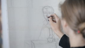 Girl draws pencil on an easel stock footage