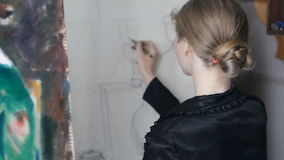Girl draws pencil on an easel stock video footage