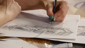 The girl draws pencil sketch on paper. Close up stock video footage