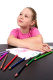 The girl draws a picture color pencils. Happy Royalty Free Stock Images