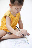 Girl draws a picture paints Stock Photos