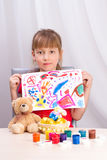 The girl draws a picture paints Stock Images