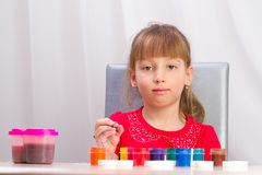 The girl draws a picture paints Stock Photography