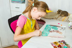 The girl draws a rabbit. Stock Images