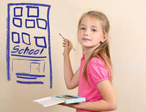 Тhe girl draws the school building on a wall Royalty Free Stock Photography