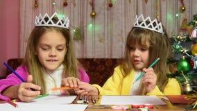 The girl draws at table Christmas drawing stock video