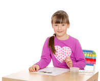 The girl draws the table Stock Images