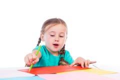 Girl draws at the table Royalty Free Stock Photos