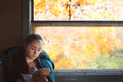 Girl draws in train Royalty Free Stock Photography