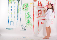 Girl draws on the wall Stock Photo