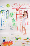 Girl draws on the wall Stock Photography