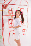 Girl draws on the wall Royalty Free Stock Photos