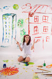 Girl draws on the wall Royalty Free Stock Photo