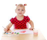 The girl draws with watercolors Royalty Free Stock Image