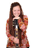 Girl with dreadlocks hair and guitar Stock Photo