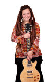 Girl with dreadlocks hair and guitar Royalty Free Stock Images