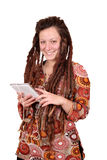 Girl with dreadlocks hair listening music on tablet Stock Photo