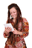 Girl with dreadlocks hair play tablet pc Royalty Free Stock Images