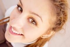 Girl with dreadlocks laughs Stock Photo