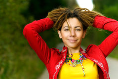 Girl with dreadlocks laughs Royalty Free Stock Images