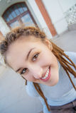 Girl with dreadlocks laughs Stock Images