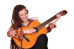 Girl with dreadlocks play acoustic guitar Royalty Free Stock Photos