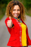 Girl with dreadlocks speaks - ok!. Beautiful woman with dreadlocks shows big finger - all will be excellent Stock Images