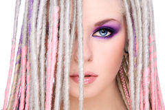 Girl with dreads. Close-up portrait of young beautiful girl with stylish make-up and dreads Stock Image