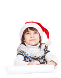 Girl dream about gifts and thinking what to write in a letter to santa on white Royalty Free Stock Photos