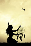 Girl with dreamcatcher at sunset Stock Photography