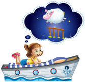 Girl dreaming on bed shaped of ship Royalty Free Stock Photo