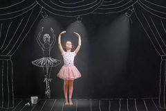 Girl dreaming a dansing ballet on the stage. Baby girl dreaming a dansing ballet on the stage. Childhood concept royalty free stock image