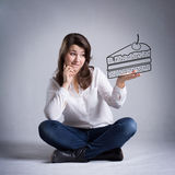Girl dreaming about eating cake Stock Photo