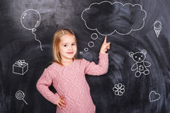 Girl dreaming about gifts Stock Images