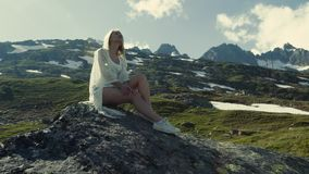 Girl is dreaming on the mountain hill, the sun is shining, joyful time. stock footage