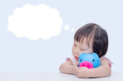 Girl dreaming with piggy bank Royalty Free Stock Image