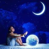 Girl dreaming before sleep Stock Images